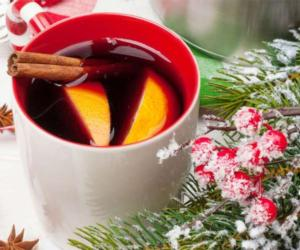mulled cider or wine next to holly