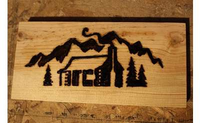 wood burning image of a house