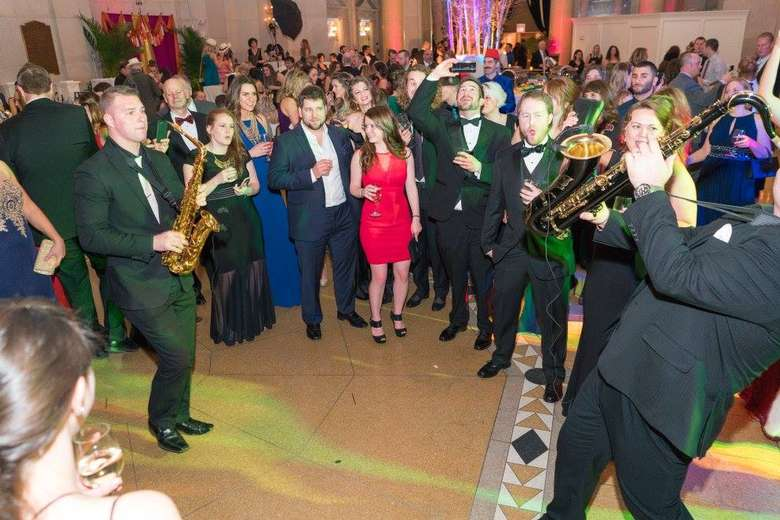 a crowd crowd dancing at a gala