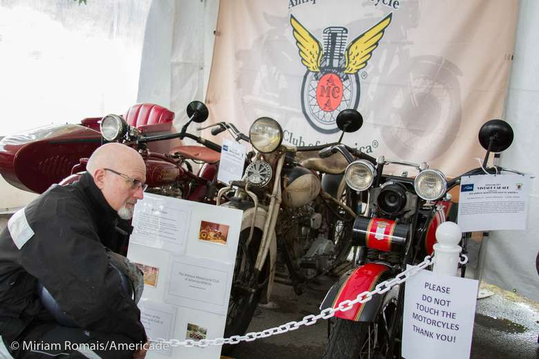 some motorcycles on display at an exhibition