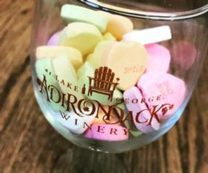 candy hearts in an adk winery wine glass