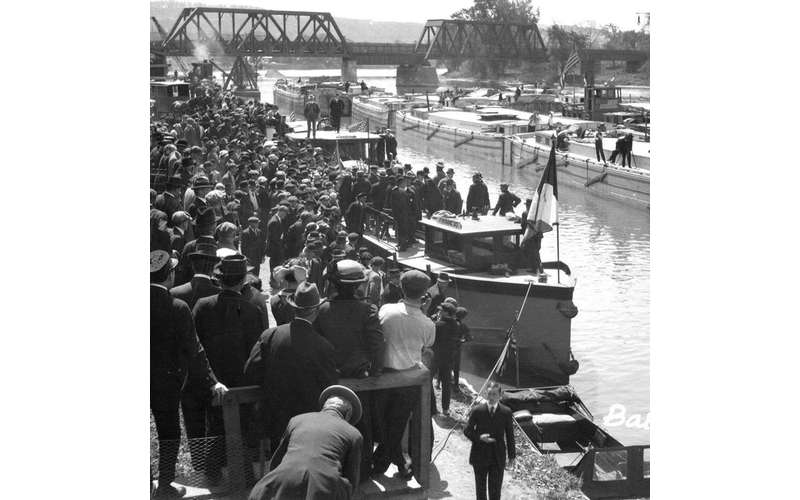 black and white image of people near the canal