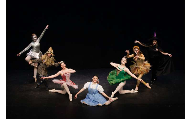 dancers performing as a variety of wizard of oz characters