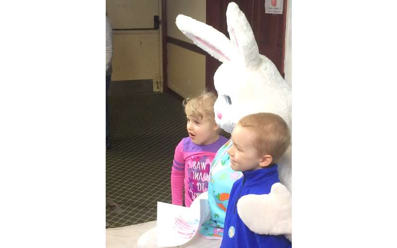 two kids posing with the Easter Bunny