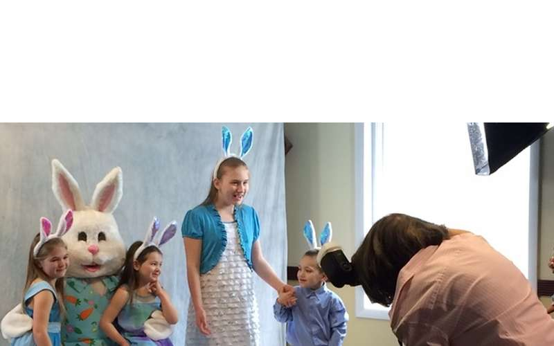 kids posing with Bunny, girl with bunny ears
