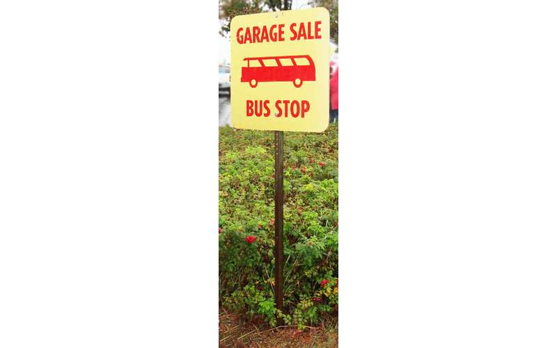 a garage sale bus stop sign