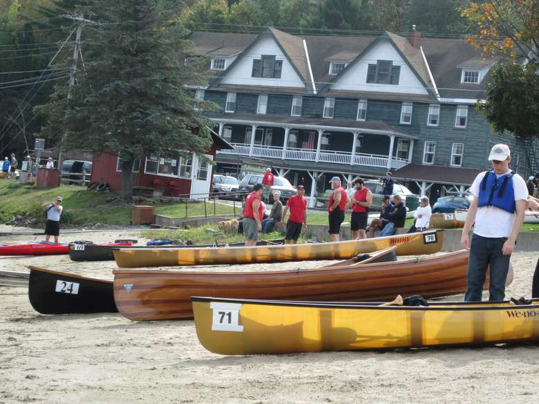 people standing near canoes