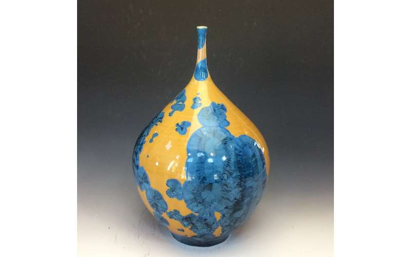 a fancy blue vase with yellow coloring