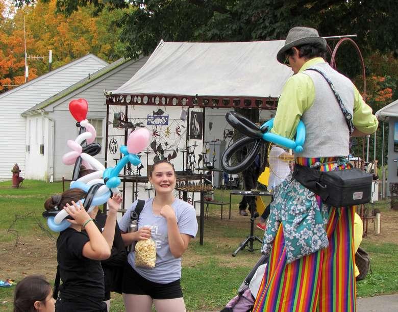 man on stilts at festival