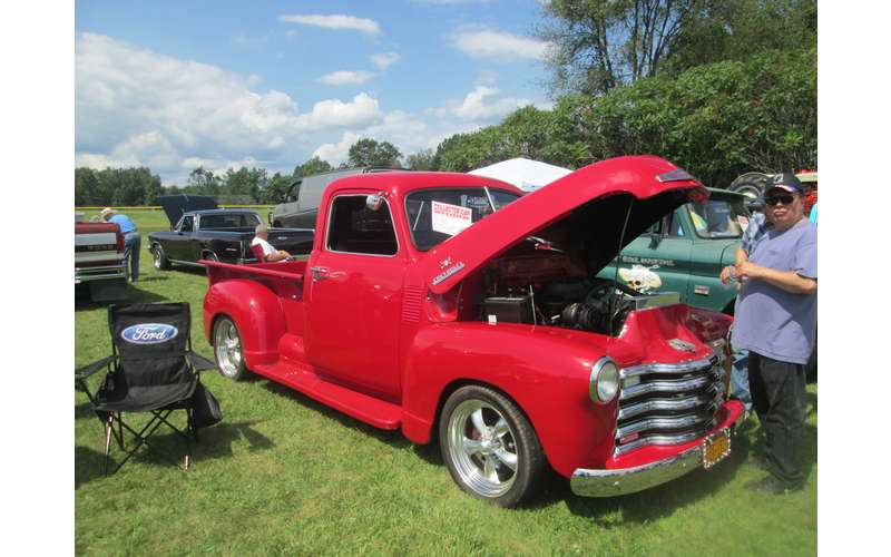 classic red truck with hood open
