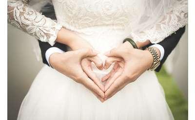 holding hands in heart shape