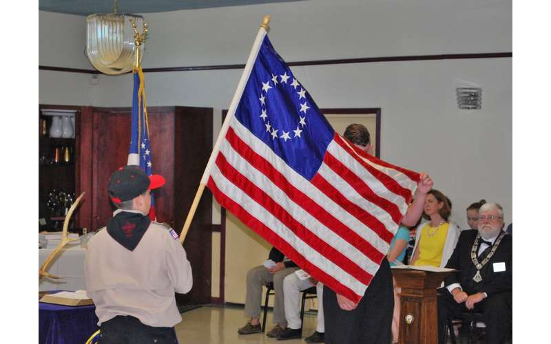 holding up a flag