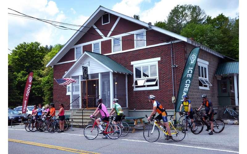 biking in front of building