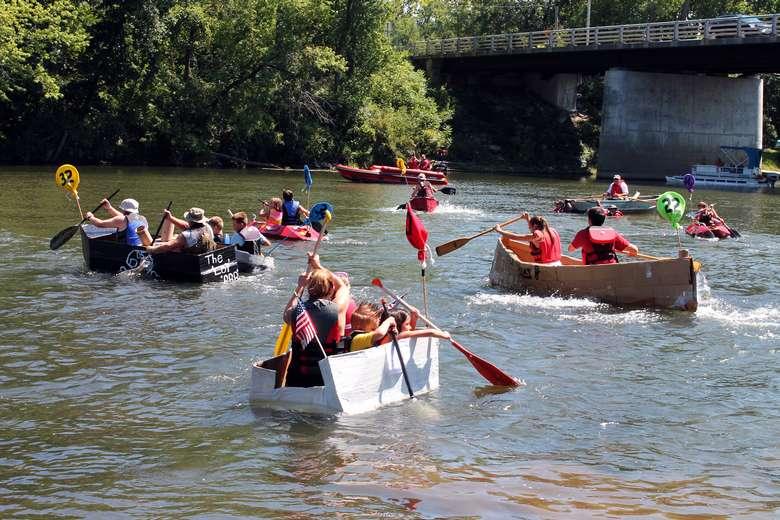 people in cardboard boats