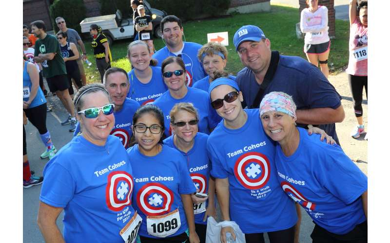 group of people in superhero blue shirts