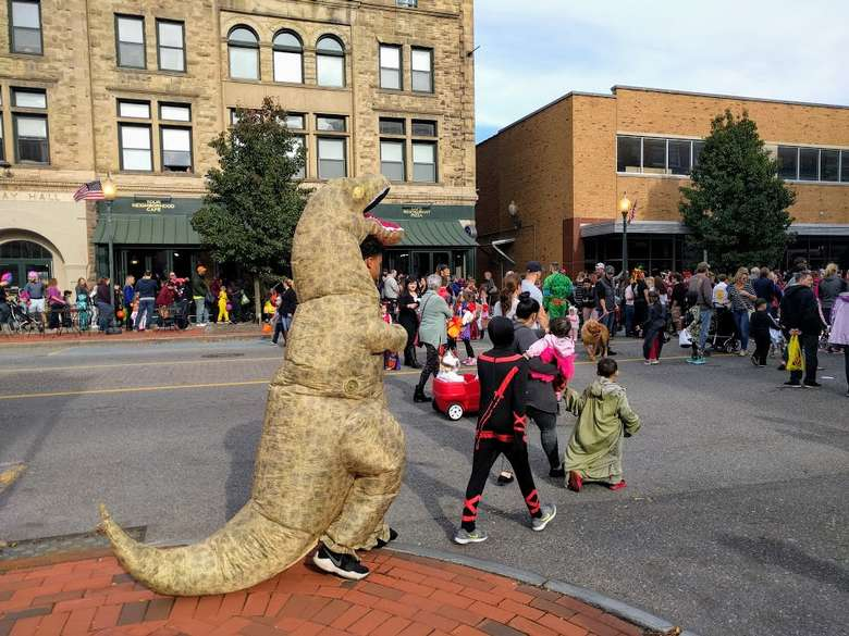 person in large dinosaur costume