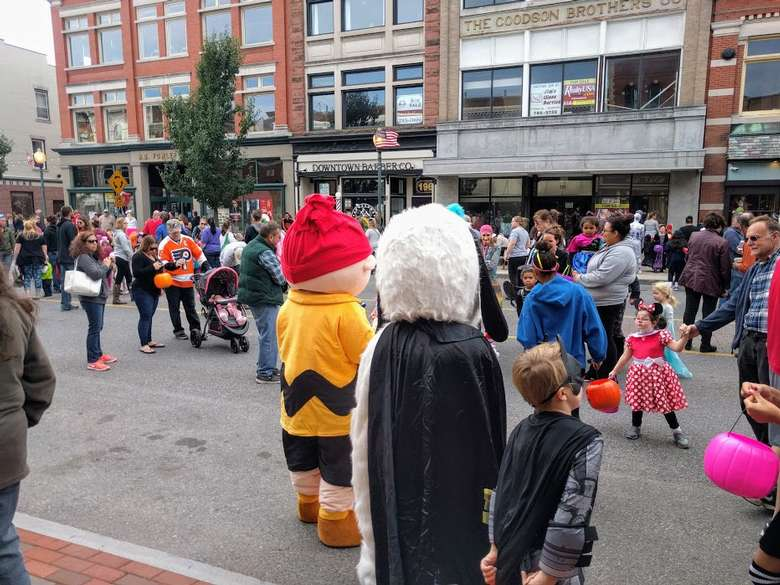 people in street in Glens Falls in costumes