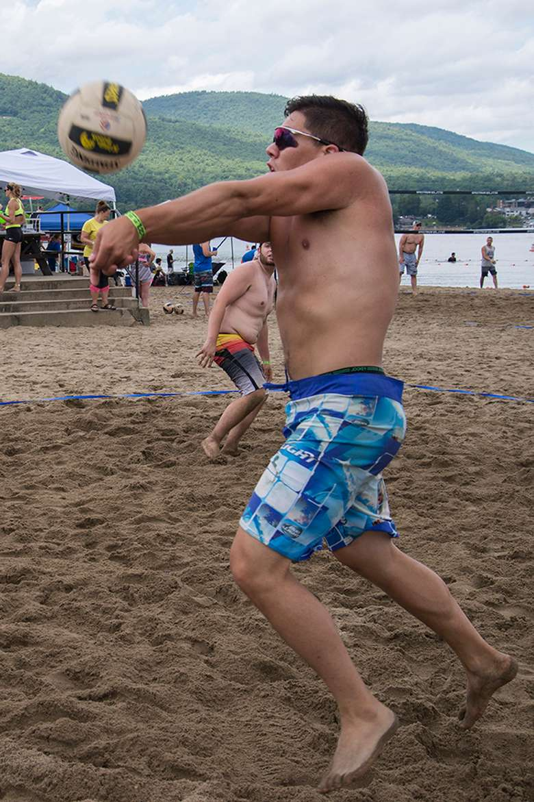 man about to hit a volleyball