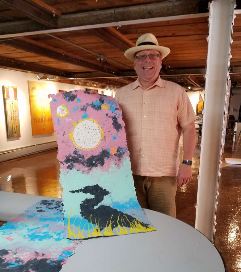 man holding artwork