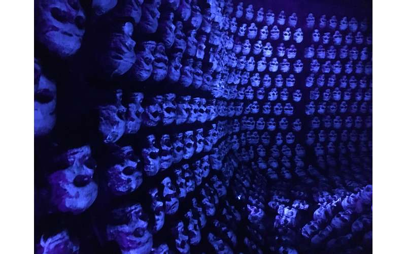 a blue wall of skulls