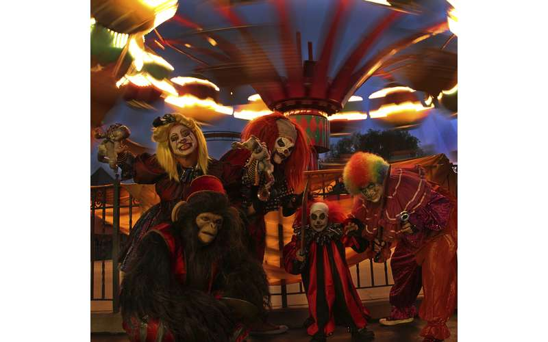 evil clowns in front of a ride