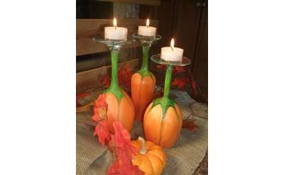 Wine glass painted as a pumpkin. The stem is green like a vine. Turned upside down becomes a tea light holder.