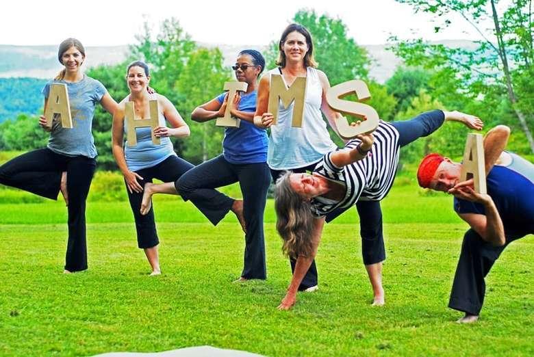 people doing yoga poses