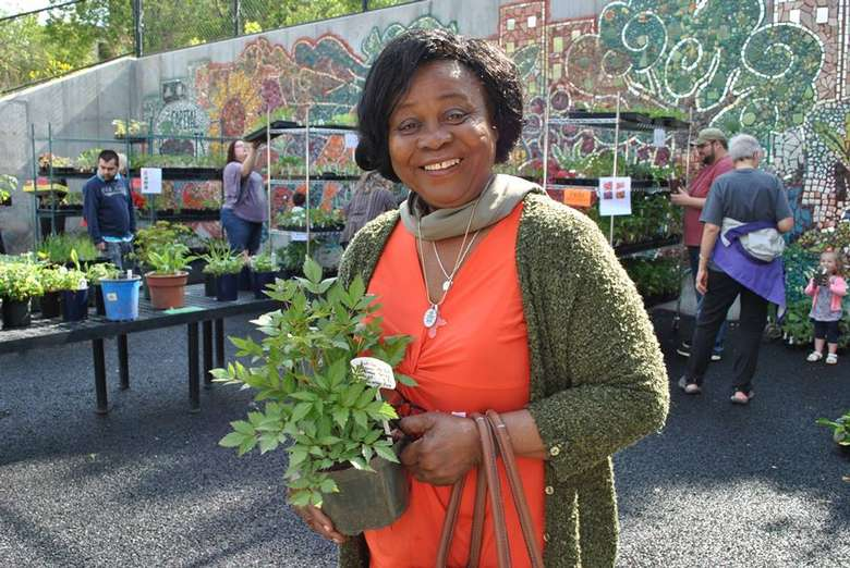 Photo of woman holding plant