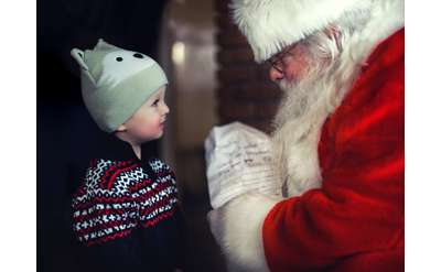 Child talking to santa