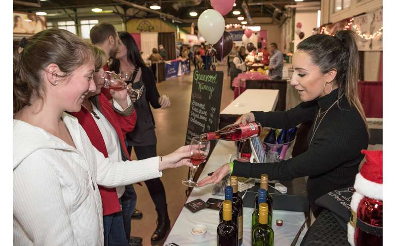 Photo of a booth serving wine at the Albany Wine & Chocolate Festival