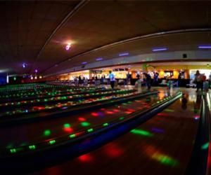 people bowling in the dark