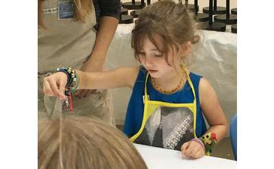 Photo of child in art lab event