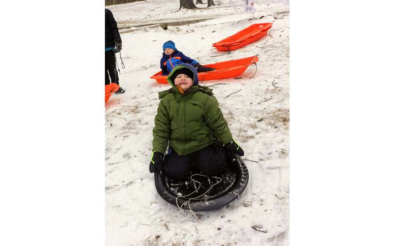 kid about to sled down a hill