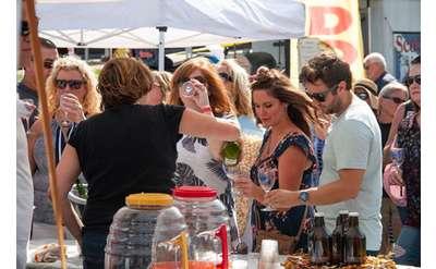 Photo of people sampling wine