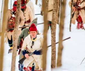 reenactors in the woods in winter