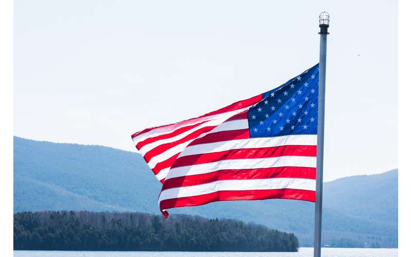 american flag flying at the stern of the lac du saint sacrement