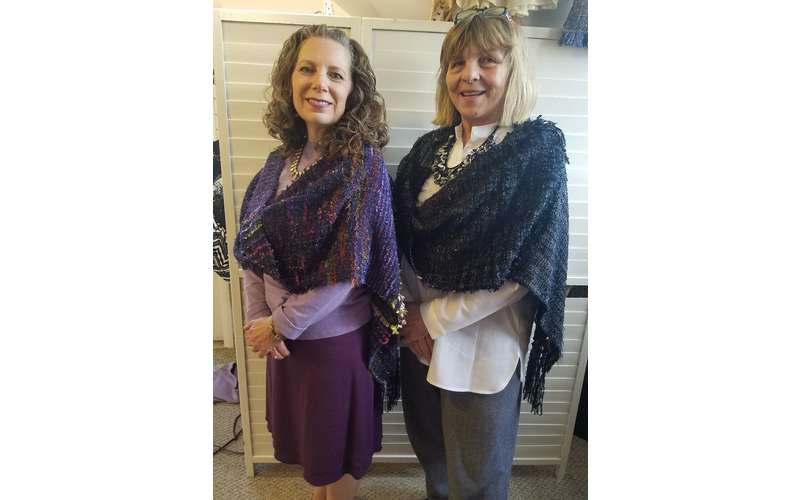 Photo of two people wearing Mobius Wrap Shawls