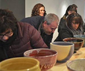 people looking at chili bowls