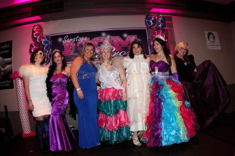 women posing for photo at mom prom