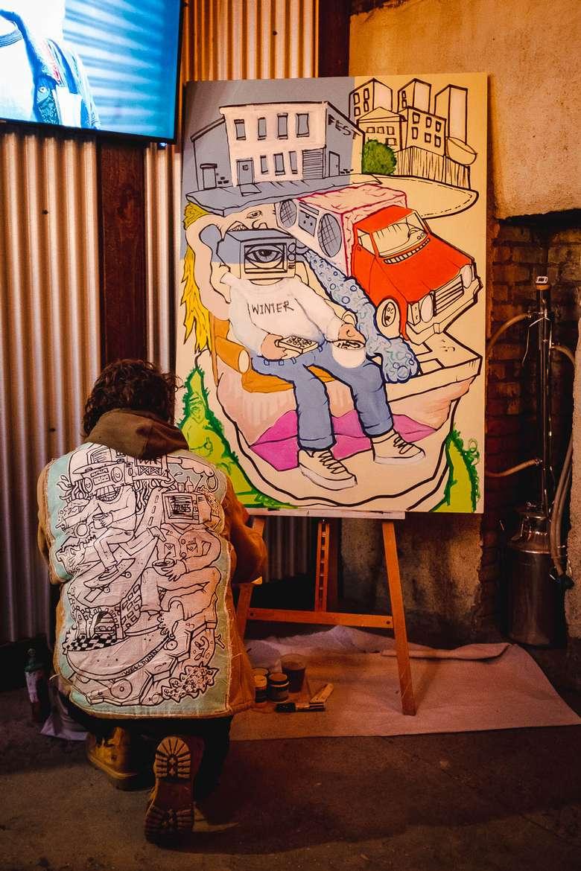 person near artwork
