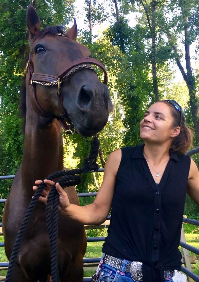woman and a horse