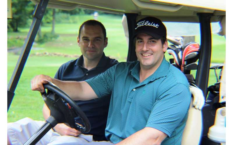 two golfers in golf cart