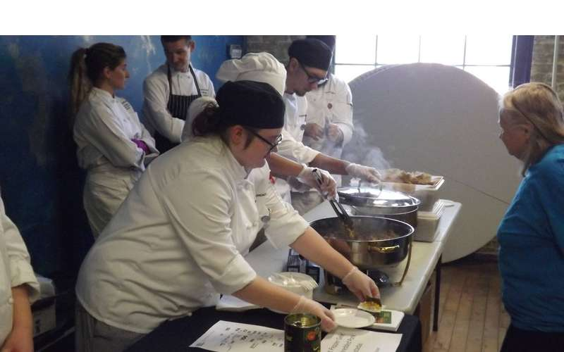 Photo of cooks serving food