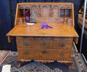 wooden chest with purple ribbon