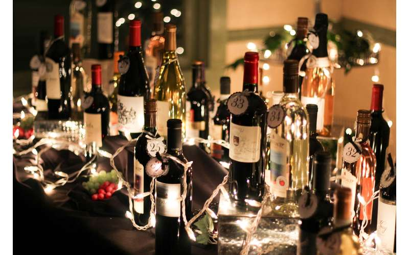 wine bottles surrounded with white lights