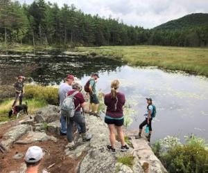 group of hikers near a pond
