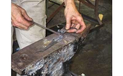 Person Blacksmithing Photo
