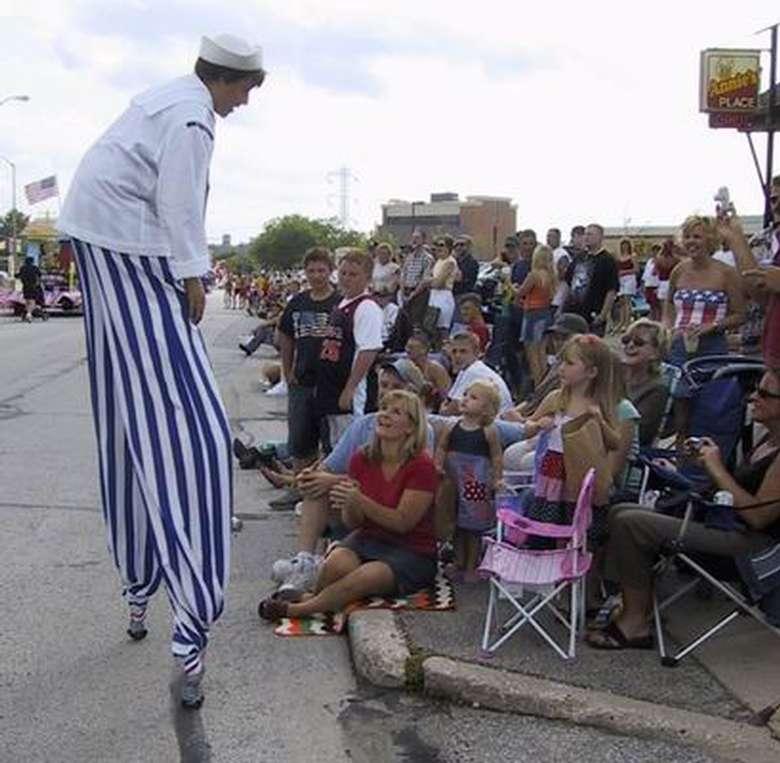 stilt walker with crowd