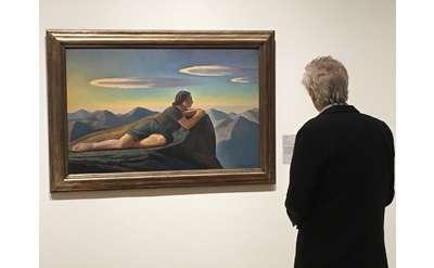 Senior looking at painting photo