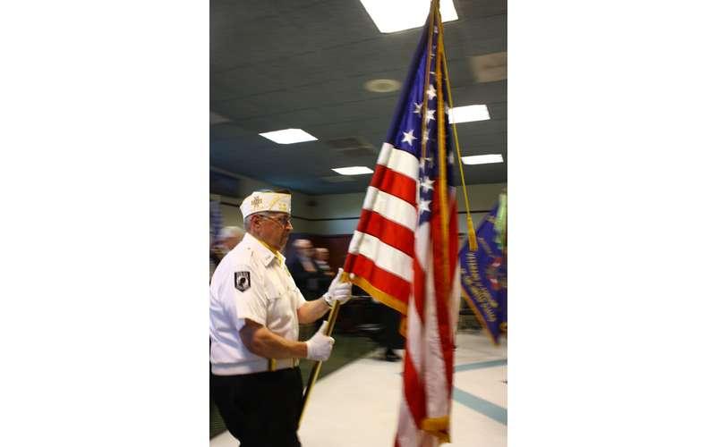 Veteran Holding Flag Photo